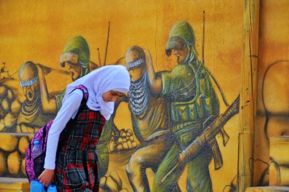 Ramallah Women Girl walking while looking down at the ground in Ramallah, Palestine,Women of Ramallah